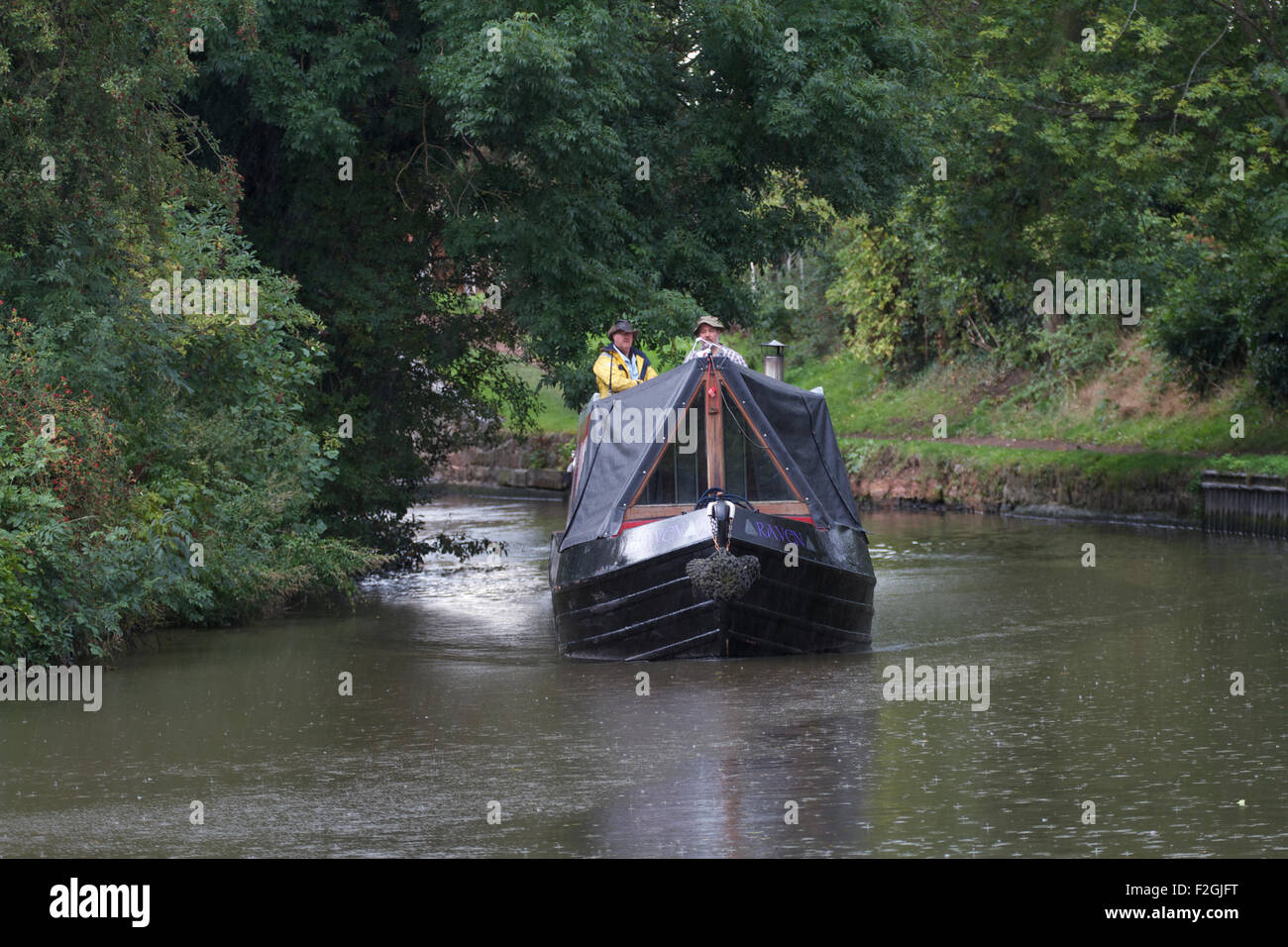 Barge in the rain , on the Staffordshire and Worcestershire Canal near Penkridge. UK Stock Photo