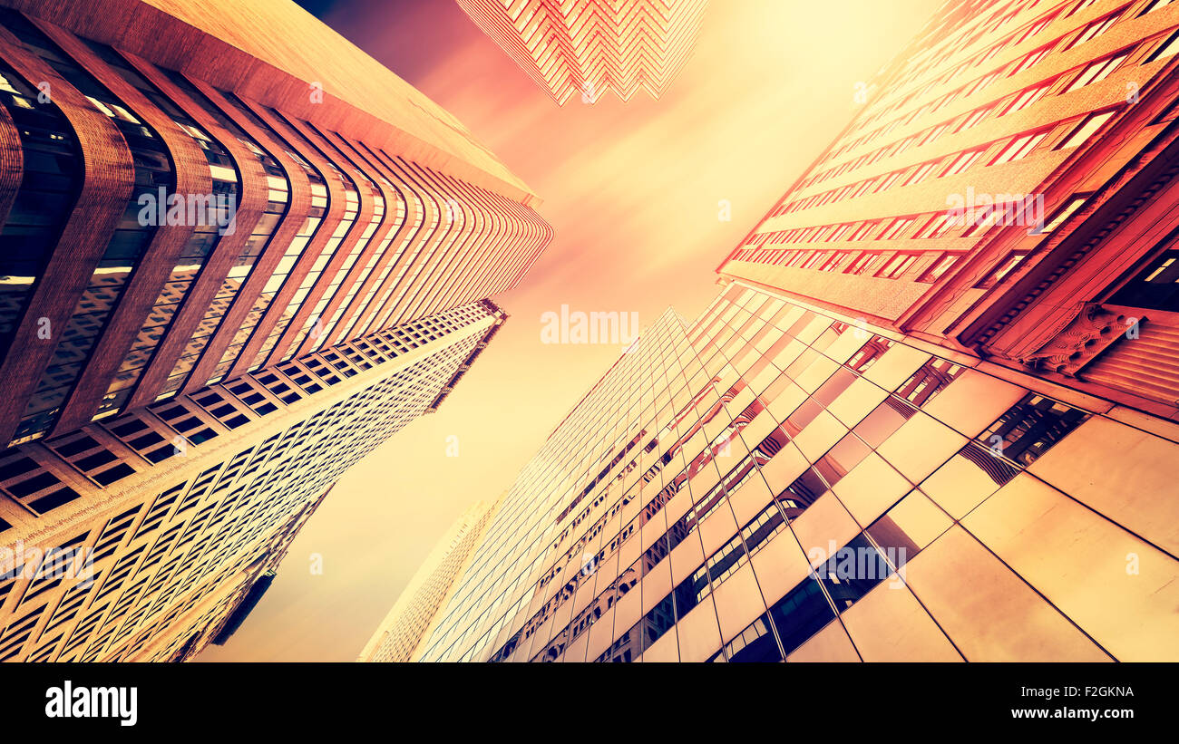 Vintage instagram filtered photo of skyscrapers in Manhattan at sunset, New York City, USA. - Stock Image