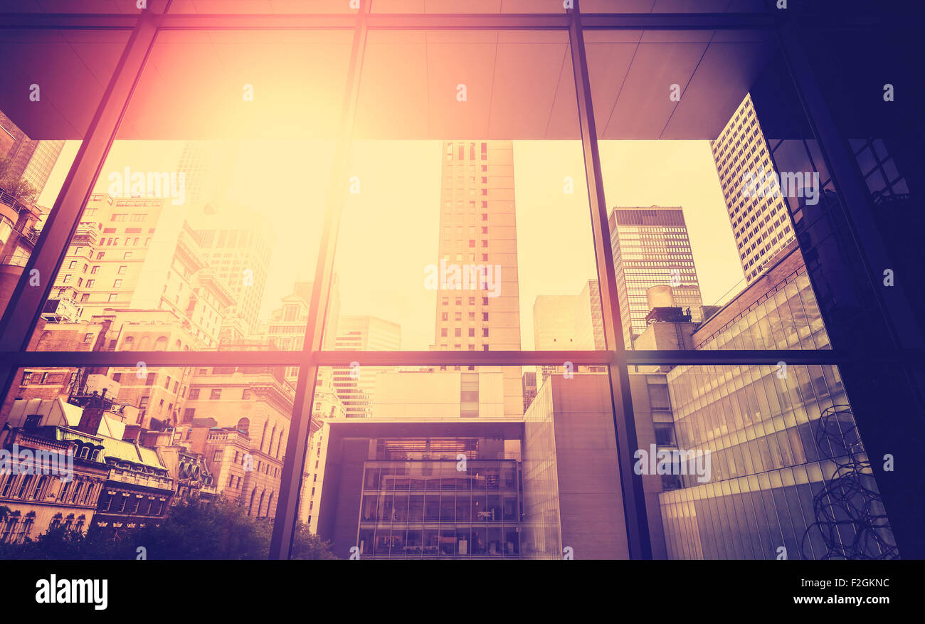 Vintage stylized picture of Manhattan with sun flare effect, New York City, USA. - Stock Image