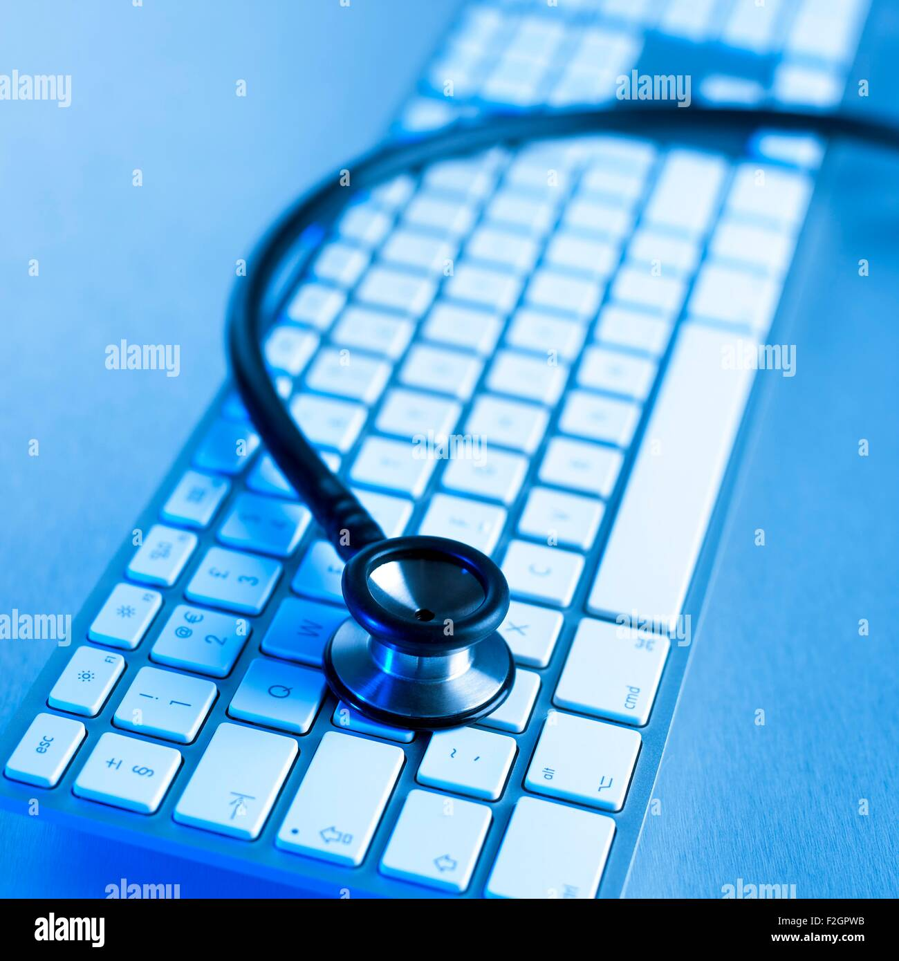 Computer keyboard and stethoscope - Stock Image