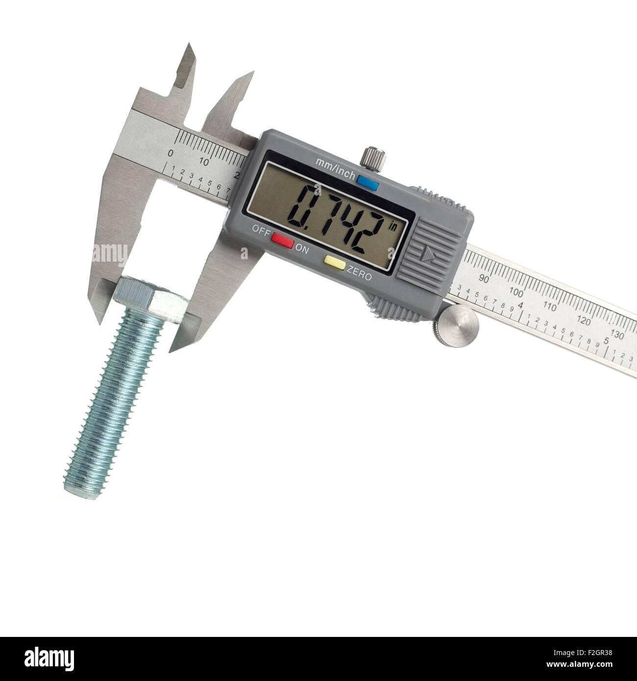 Digital caliper measuring a bolt - Stock Image