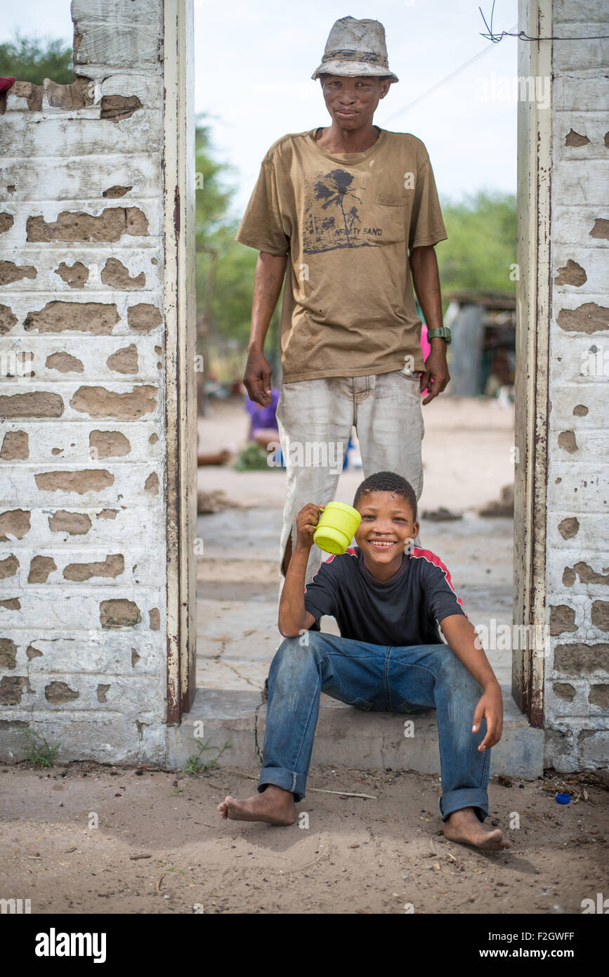 Two bushmen in their village in Botswana, Africa - Stock Image