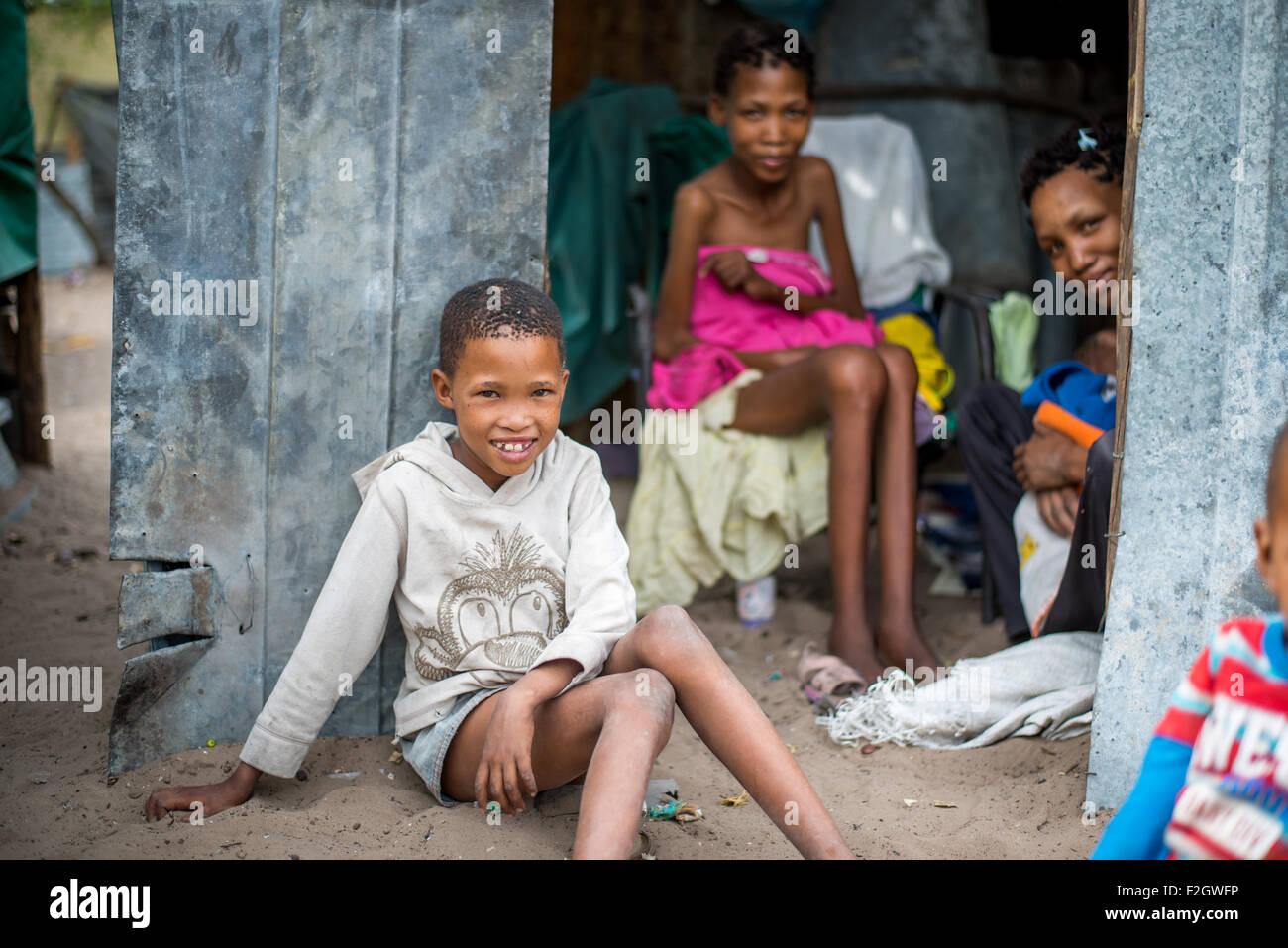 San people, or bushmen in their village in Botswana, Africa - Stock Image