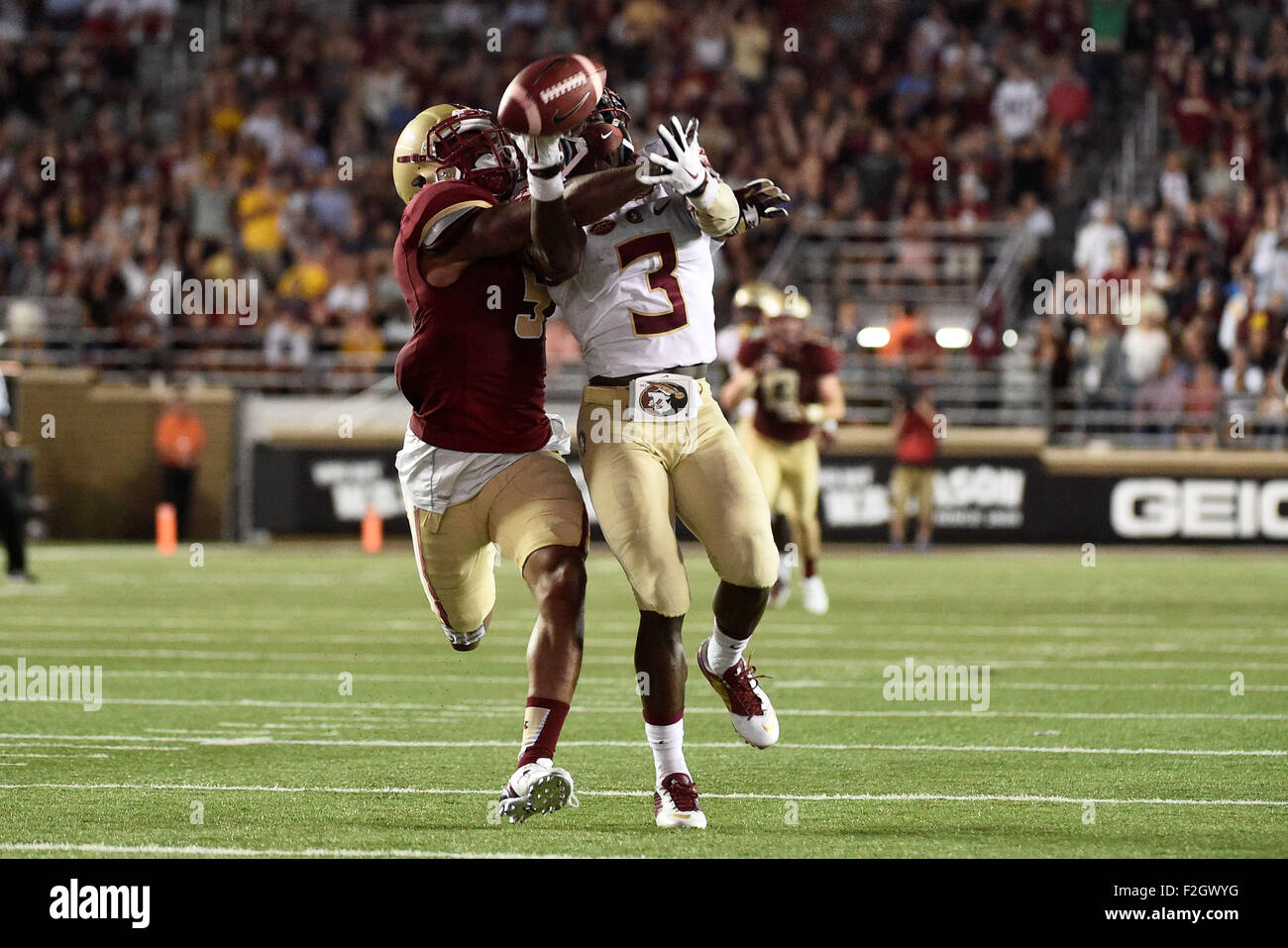 Chestnut Hill, Mass. USA. 18th Sep, 2015. Boston College Eagles defensive back Kamrin Moore (5) disrupts a pass - Stock Image