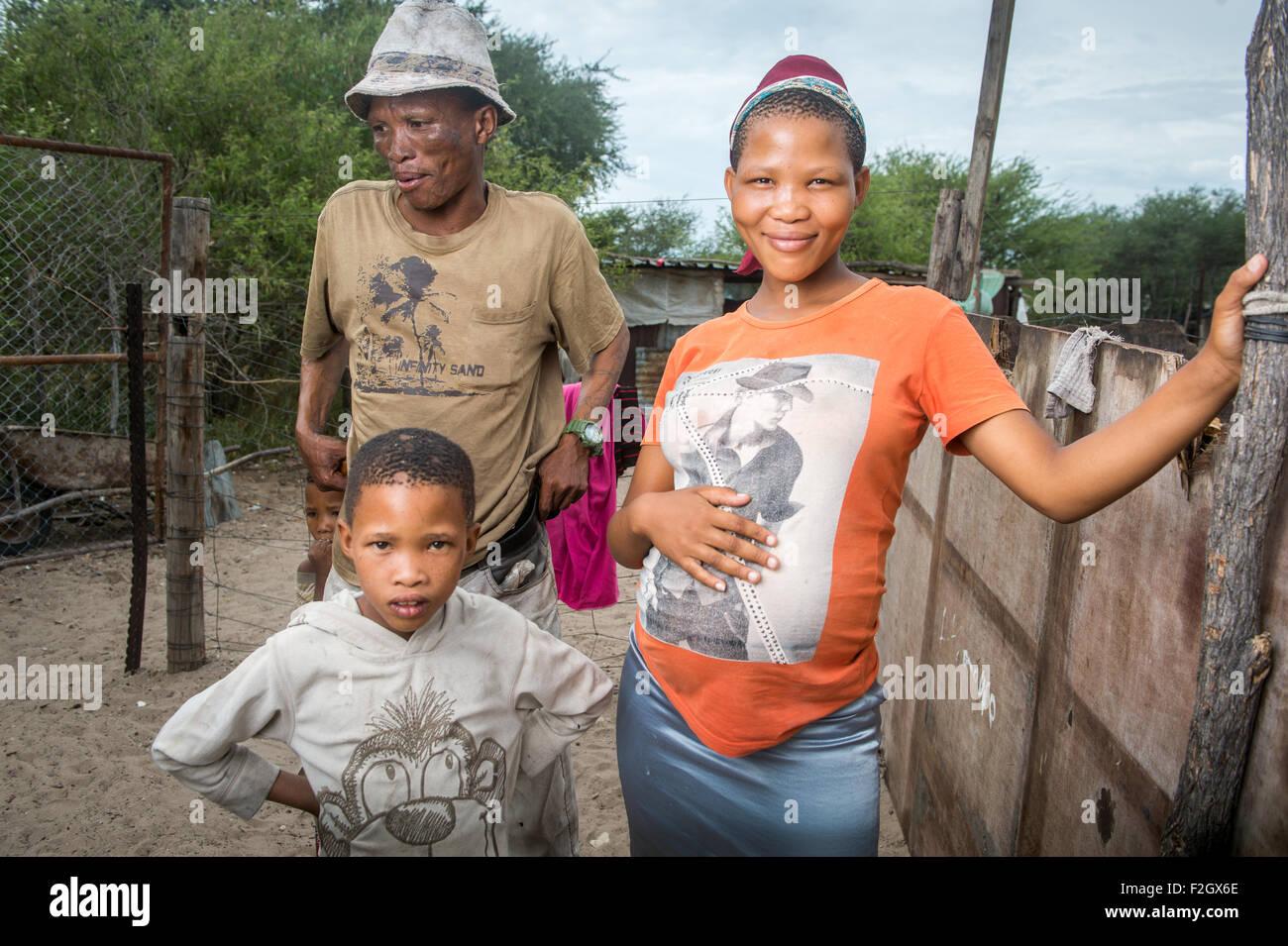 San people, or bushmen posing for a photo in Botswana, Africa - Stock Image