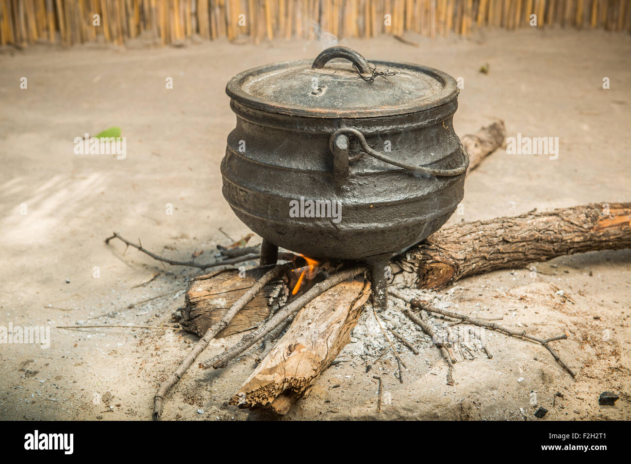 Cooking Sorghum for the Family over a fire in Botswana, Africa - Stock Image