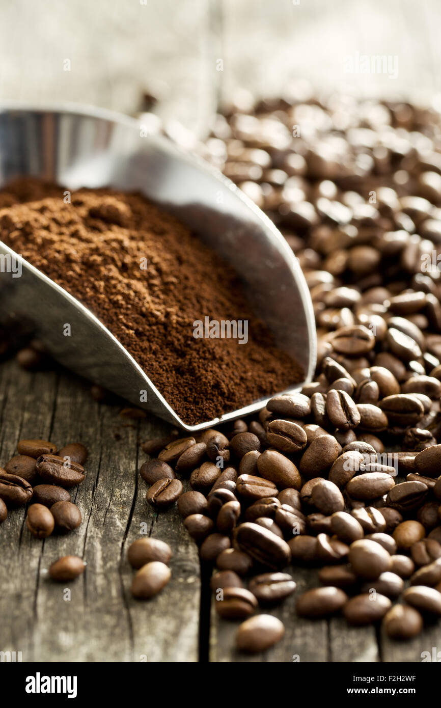 coffee beans and ground coffee in scoop - Stock Image