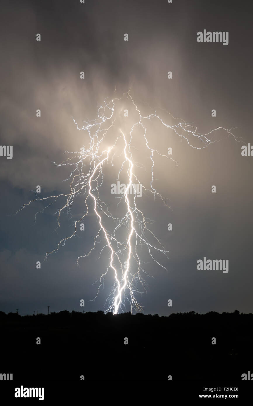 lightning and clouds in night landscape storm - Stock Image