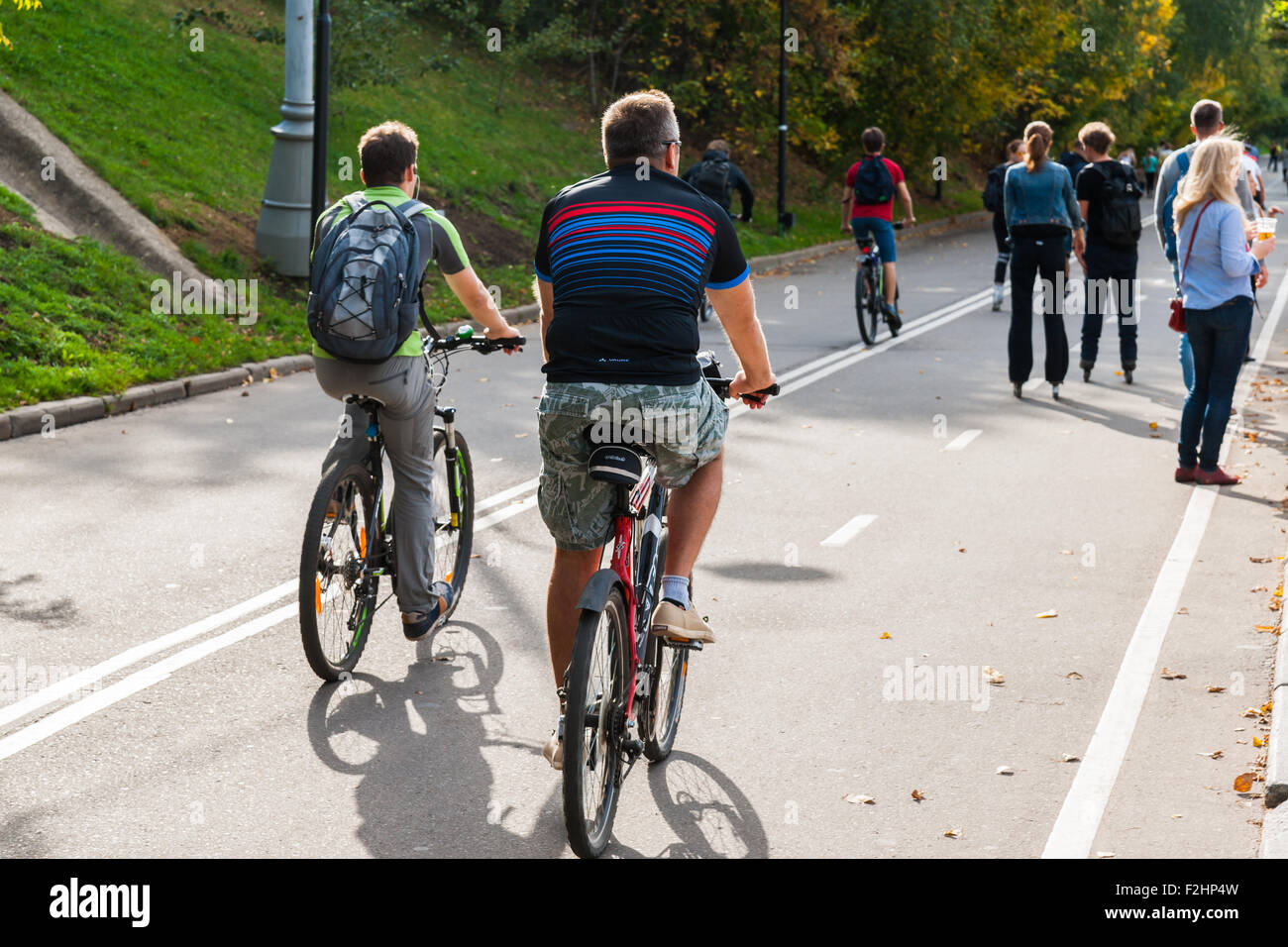 Moscow, Russia. Saturday, Sept. 19, 2015. Warm weekend. It is comfortable to be outdoors. Unidentified bikers go Stock Photo