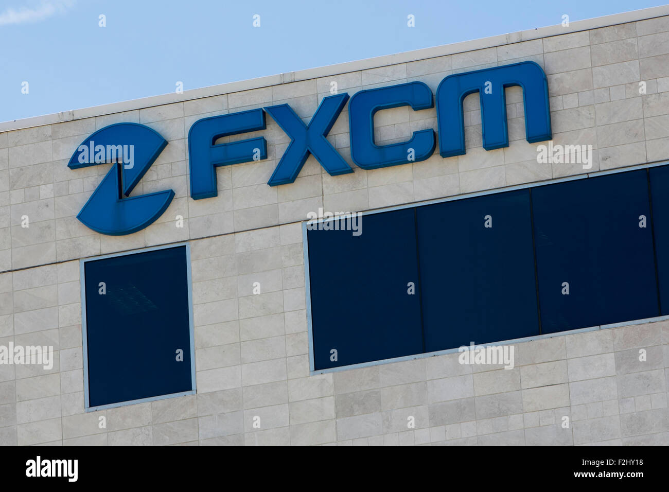 A logo sign outside of a facility occupied by Forex Capital Markets Inc., also known as FXCM, in Plano, Texas on - Stock Image