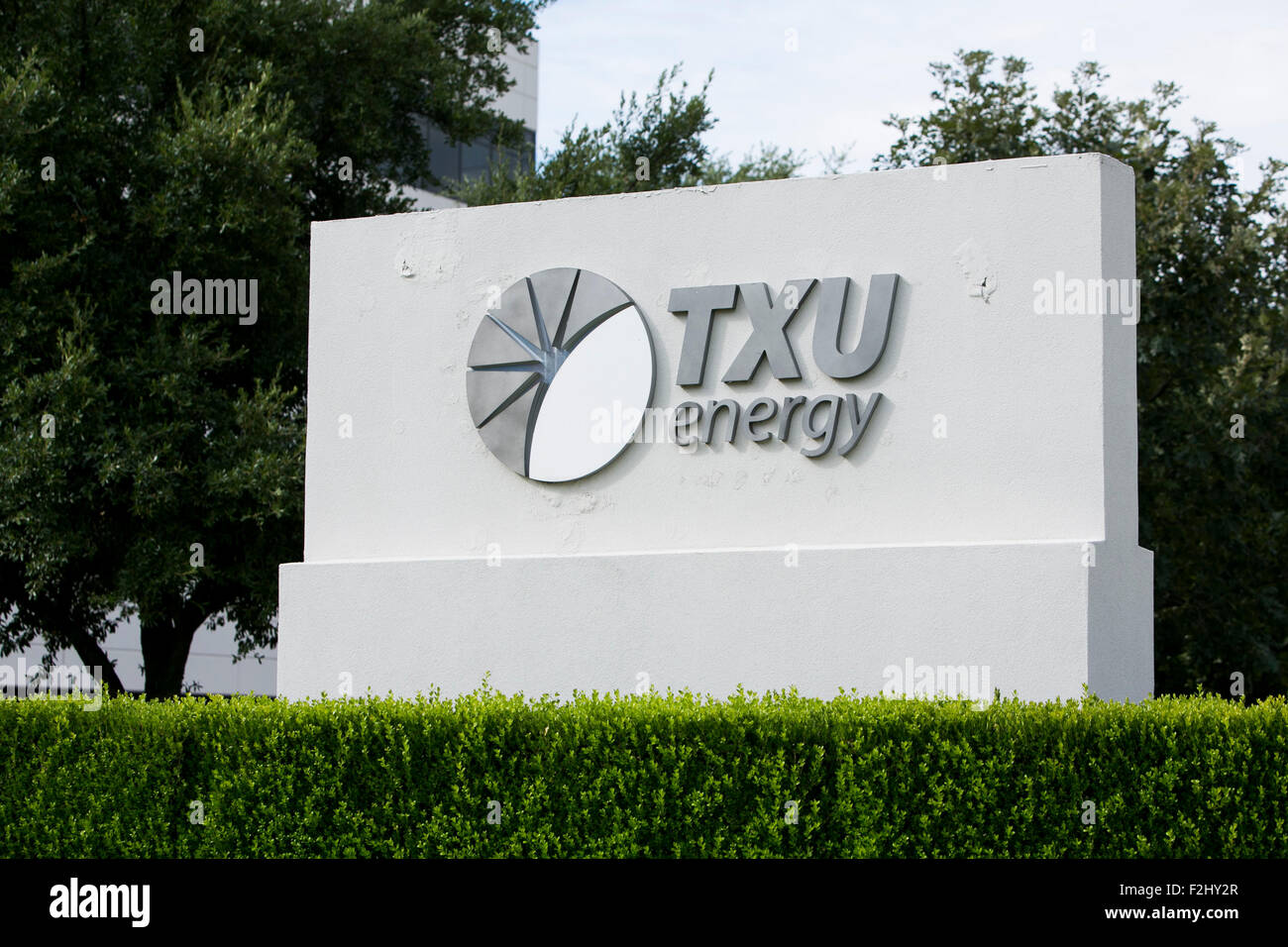 A logo sign outside of a facility occupied by TXU Energy, a