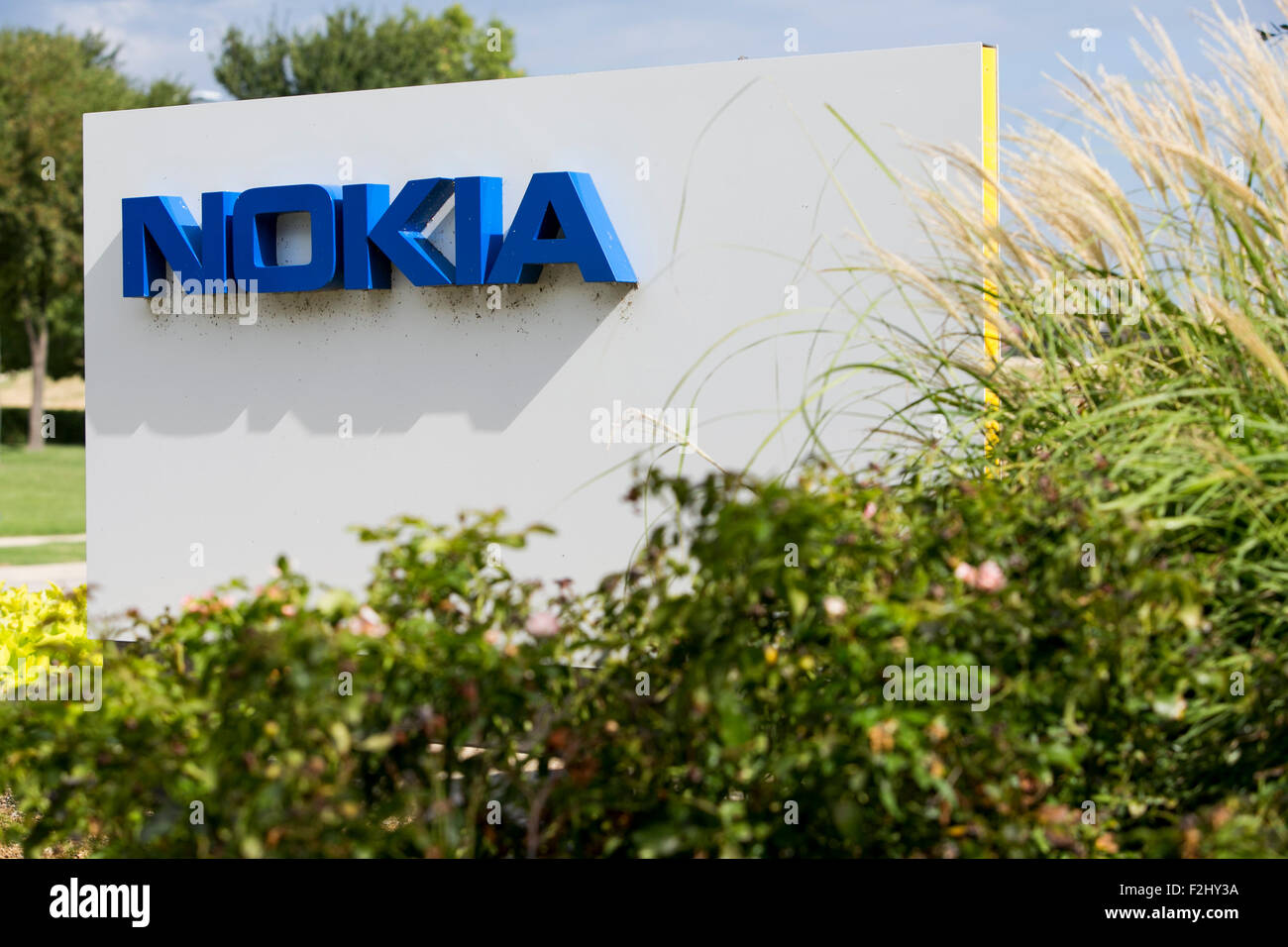 A logo sign outside of a facility occupied by the Nokia Corporation in Irving, Texas on September 13, 2015. - Stock Image