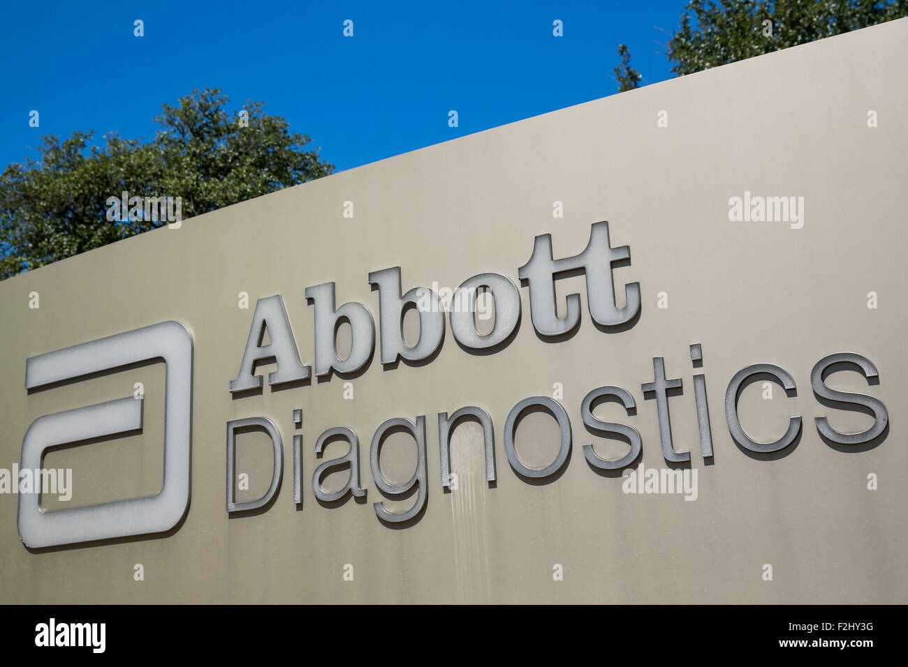 A Logo Sign Outside Of Facility Occupied By Abbott Diagnostics In Irving Texas On