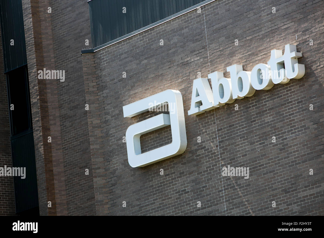 A logo sign outside of a facility occupied by Abbott Diagnostics in Irving, Texas on September 13, 2015. - Stock Image