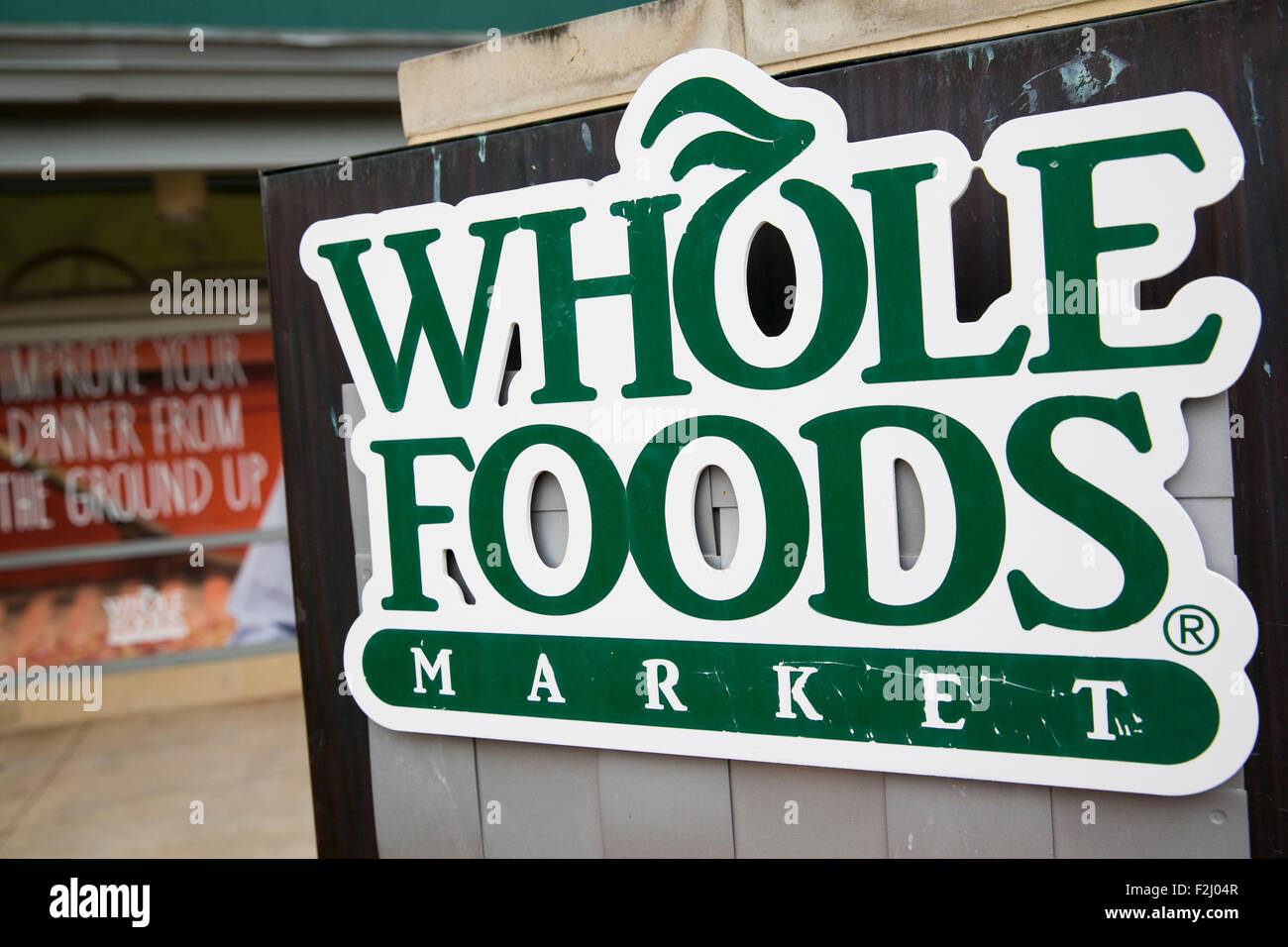 A logo sign outside of the headquarters and a store location of Whole Foods Market Inc., in Austin, Texas on September - Stock Image