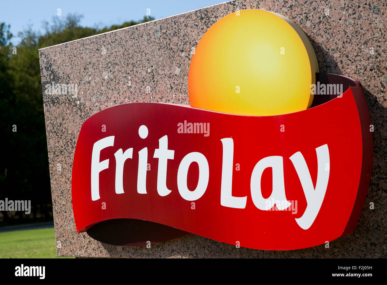 A logo sign outside of the headquarters of Frito-Lay, Inc., a subsidiary of PepsiCo, in Plano, Texas on September - Stock Image