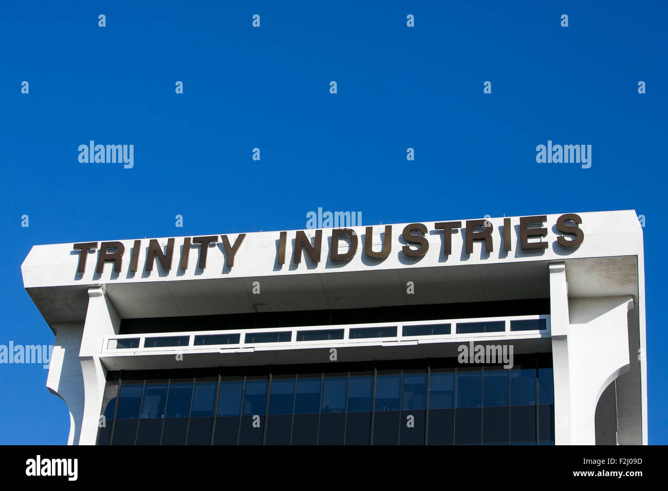 A logo sign outside of the headquarters of Trinity Industries Inc., in Dallas, Texas on September 12, 2015. - Stock Image