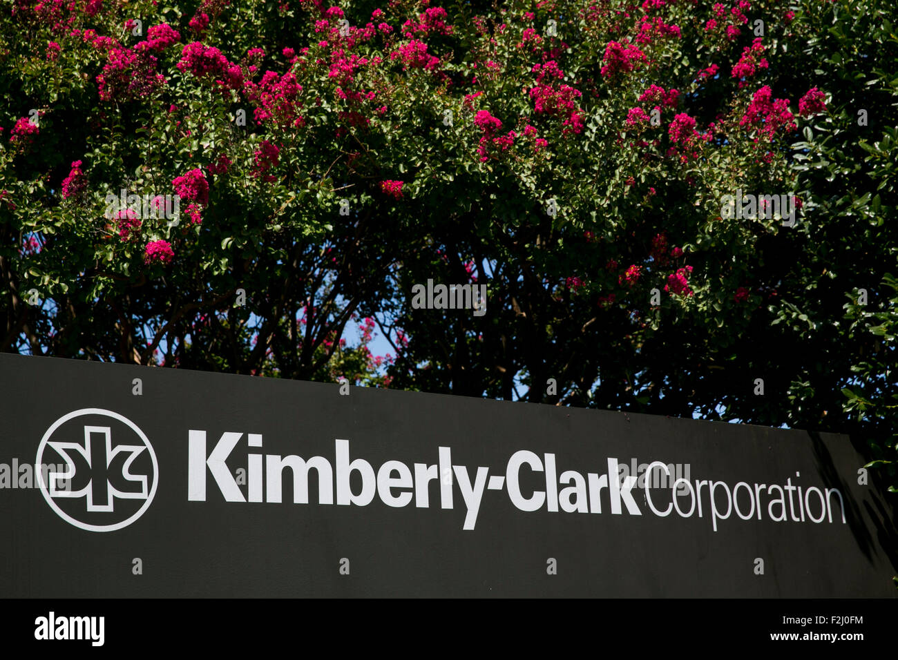 A logo sign outside of the headquarters of the Kimberly-Clark Corporation in Irving, Texas on September 13, 2015. - Stock Image