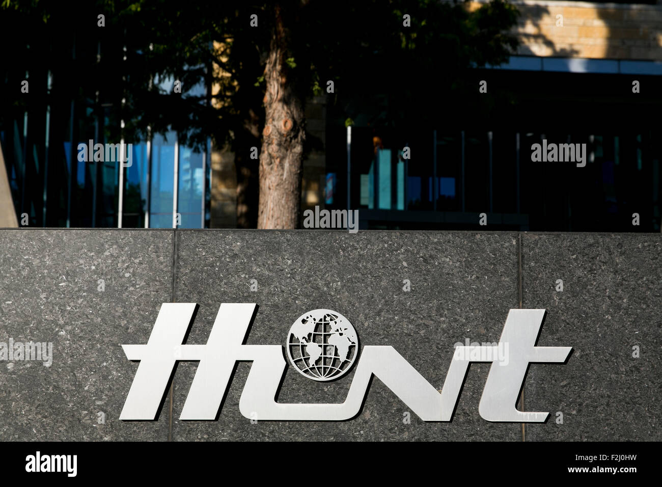 A logo sign outside of the headquarters of the Hunt Oil Company in Dallas, Texas on September 13, 2015. Stock Photo