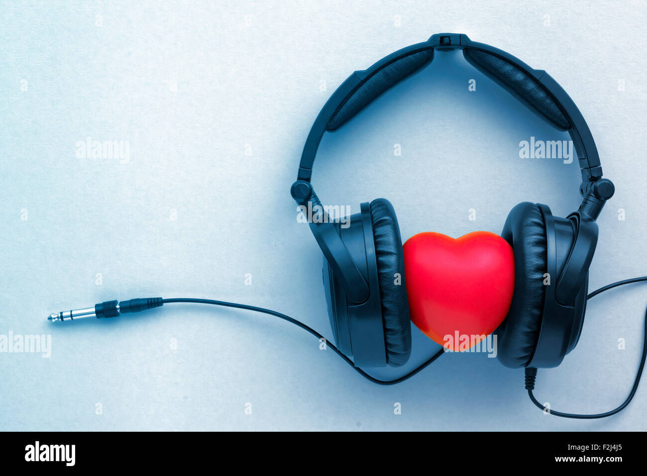 black headphones with red heart toned in blue Stock Photo: 87679933 ...