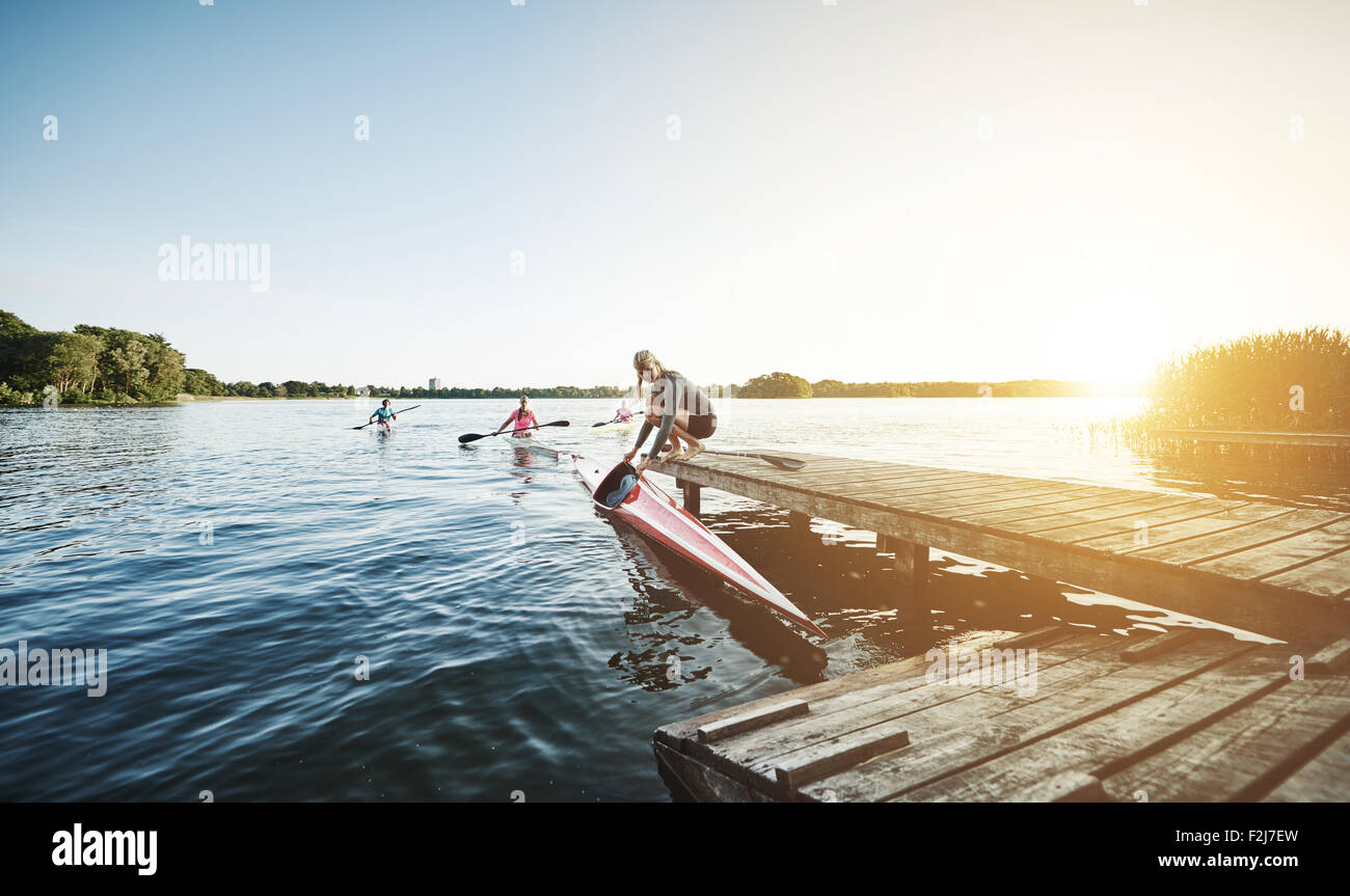 Elite sports rowing team getting ready to row - Stock Image