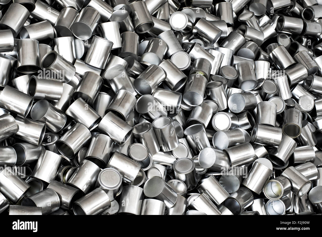 Background texture of new empty tins for canning food products viewed from overhead in a full frame view, nutrition - Stock Image