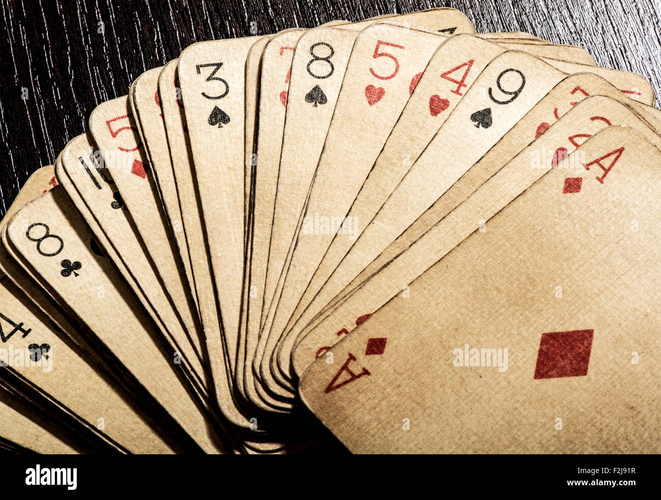Grungy discolored dirty vintage playing cards - Stock Image
