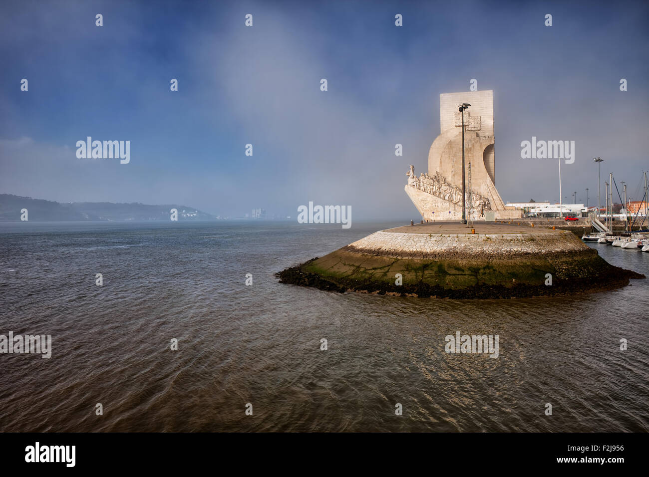 Mist at the Monument to the Discoveries and Tagus river in Belem, Lisbon, Portugal. - Stock Image