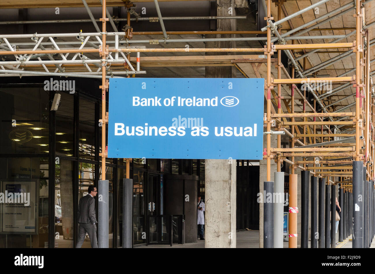 Bank of Ireland 'Business as Usual' sign. Dublin, Ireland - Stock Image