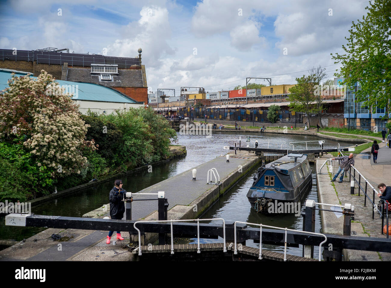Lock gates and canal boat on Regent's Canal near Camden Lock and Market in London England near MTV Viacom studios - Stock Image