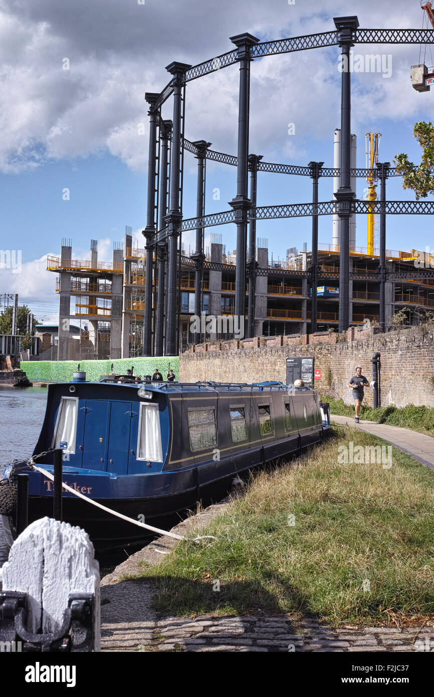 King's Cross redevelopment of Victorian gas holder moved to towpath on Regent's Canal London England - Stock Image