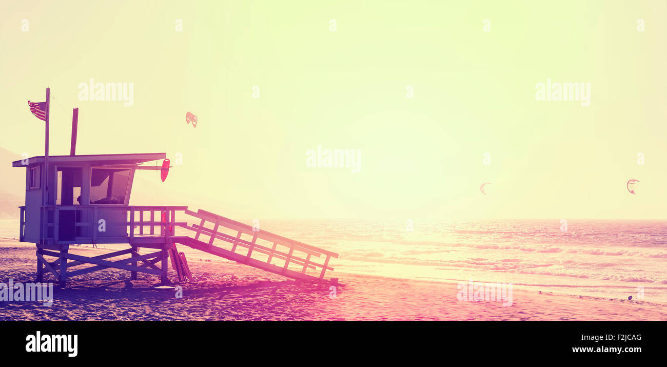 Vintage style picture of lifeguard tower at sunset in Malibu, USA. - Stock Image