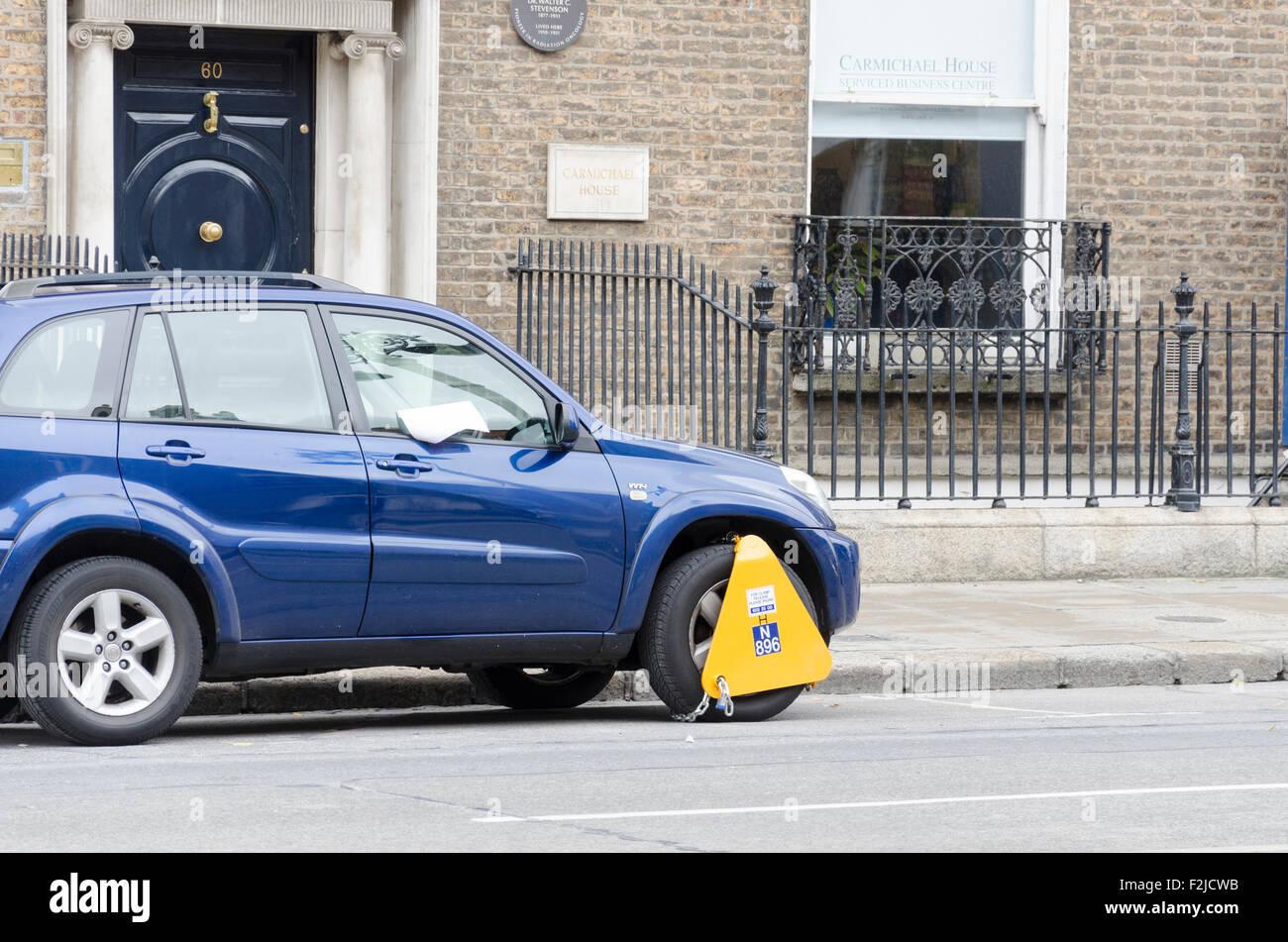 Car clamped in Dublin, Ireland - Stock Image