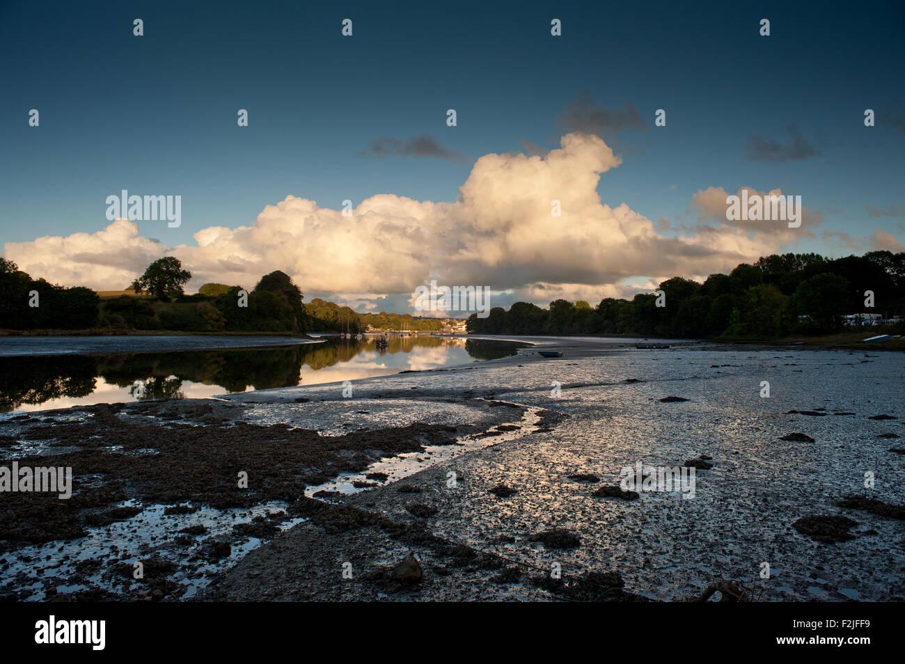 Cumulonimbus clouds sunset over cardigan from st dogmaels river teifi - Stock Image
