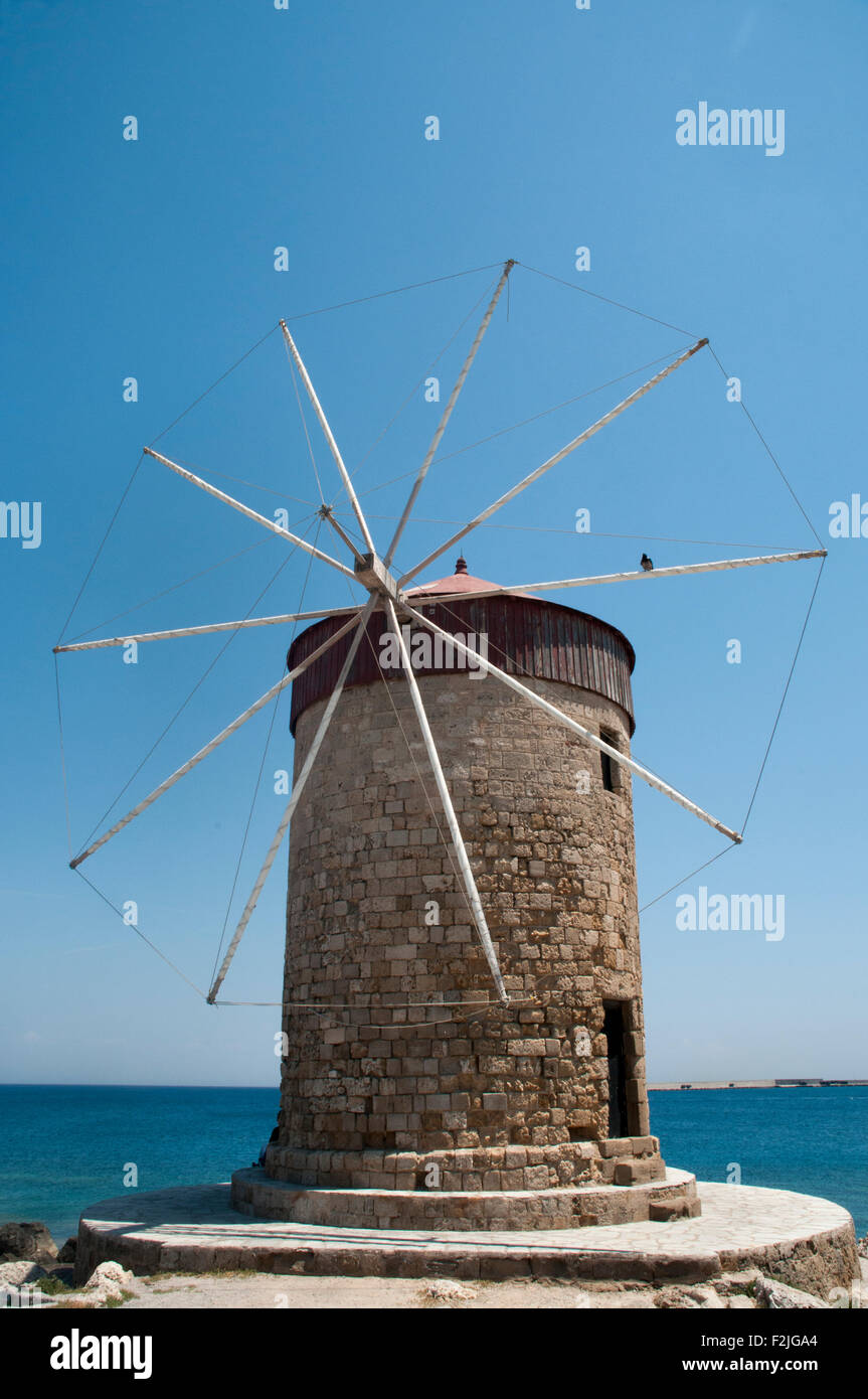 Windmill at the harbor of Rhodes in the Greek Aegean Sea. - Stock Image