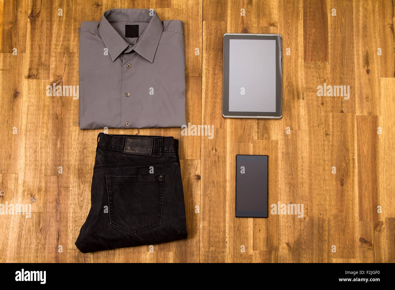 Informal male outfit with electronics, background - Stock Image