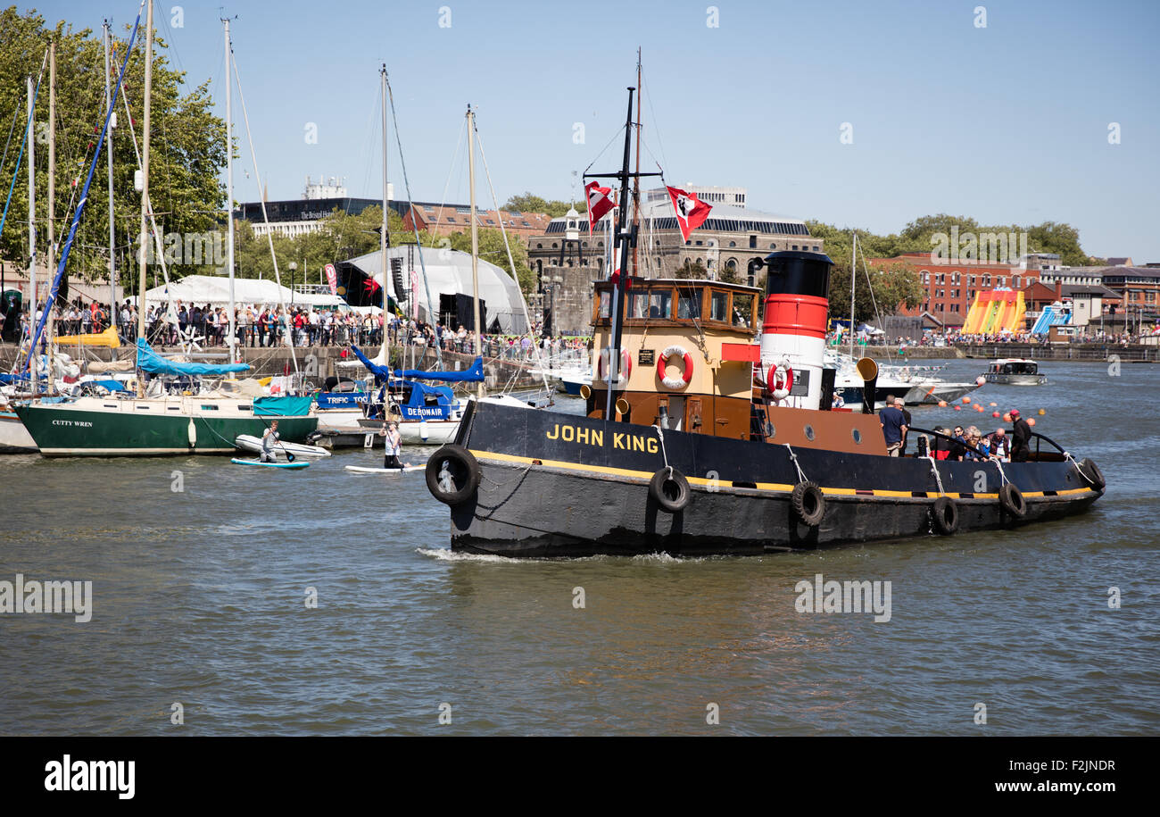 The tug boat John King sailing along Bristol's floating harbour during the harbour festival  Bristol UK - Stock Image