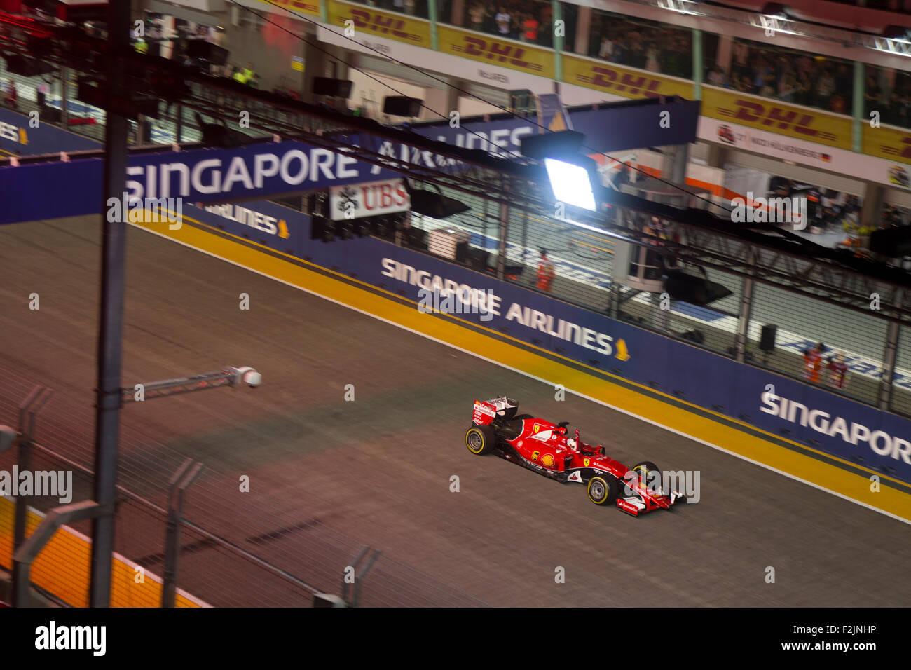 Singapore. 20th September, 2015. Sebastian Vettel of team Scuderia Ferrari gestures as he wins the Singapore Street Stock Photo