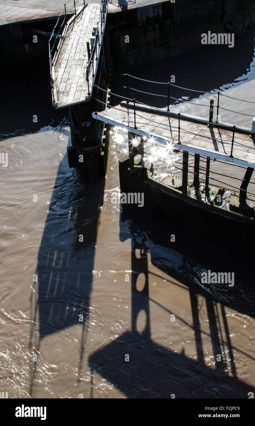Lock gates of the Brunel lock between the River Avon and Bristol's floating harbour opening at high tide - Stock Image