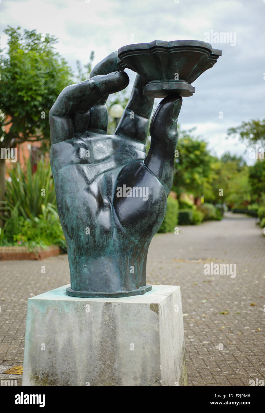 Hand of a River God on Baltic Wharf by Bristol's floating harbour - a bronze sculpture by Vincent Woropay - Stock Image