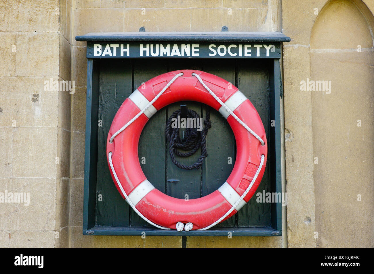LIfe belt by a canal in Bath UK supplied by the Bath Humane Society - Stock Image