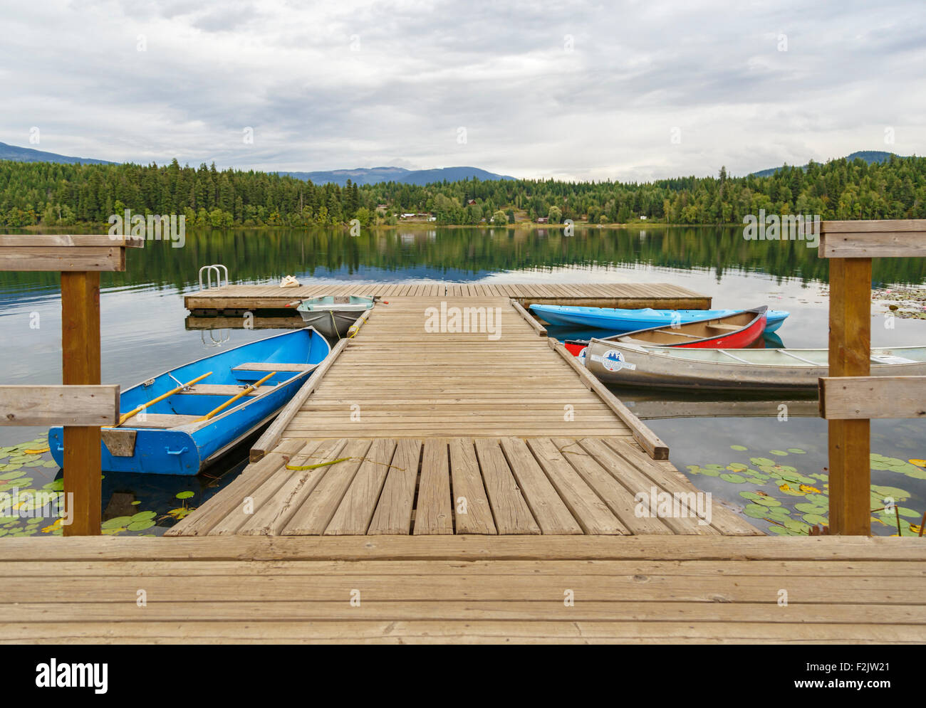 Moored boats and scenic reflections on Dutch Lake in Clearwater, British Columbia, Canada, North America. - Stock Image