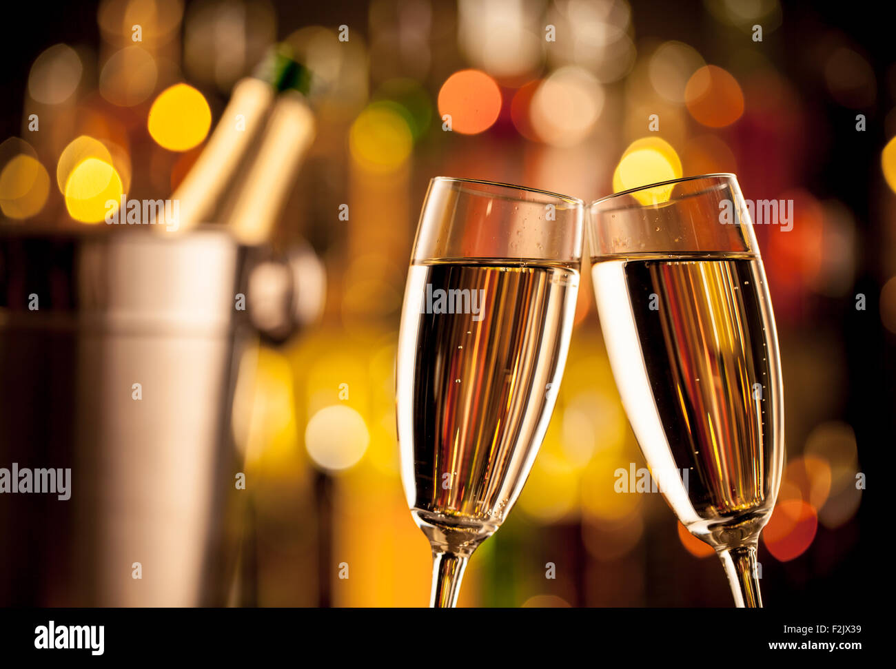 Glasses of champagne on bar counter - Stock Image