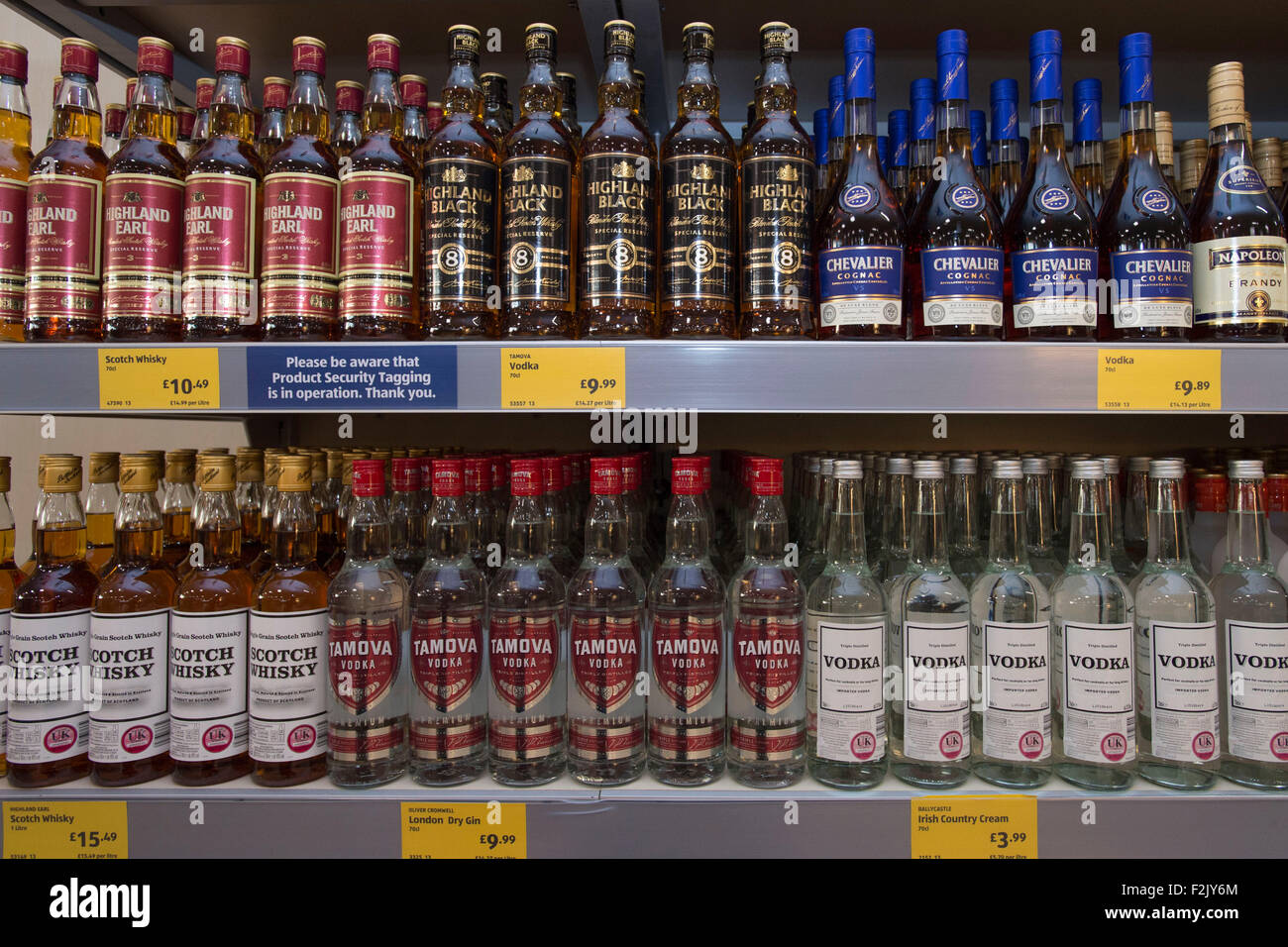 Bottles of alcoholic spirits on sale in a supermarket. - Stock Image