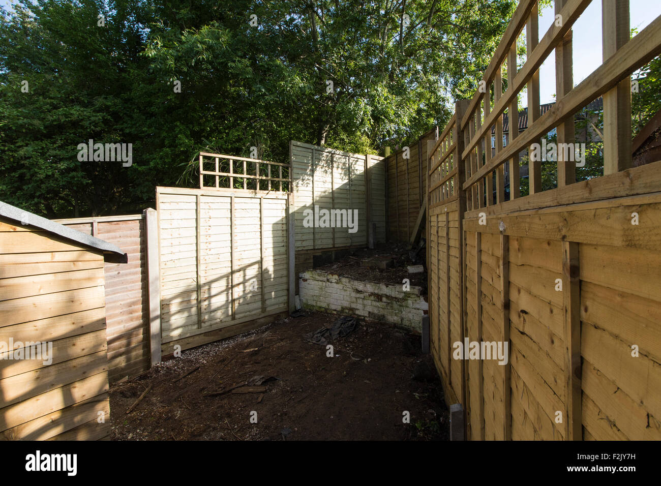 A new fence in a suburban garden Stock Photo