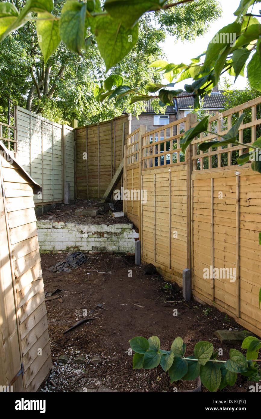 A new fence in a suburban garden - Stock Image