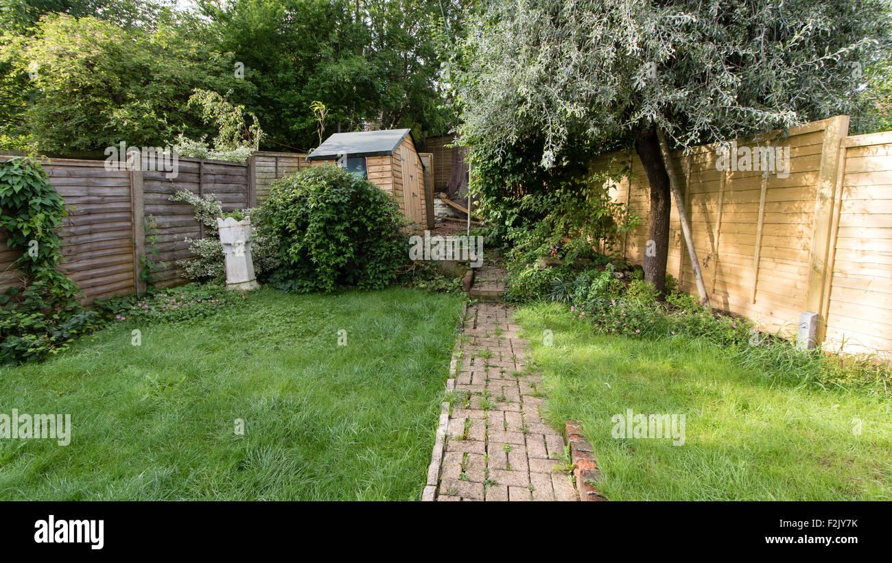 A new fence in a suburban garden Stock Photo