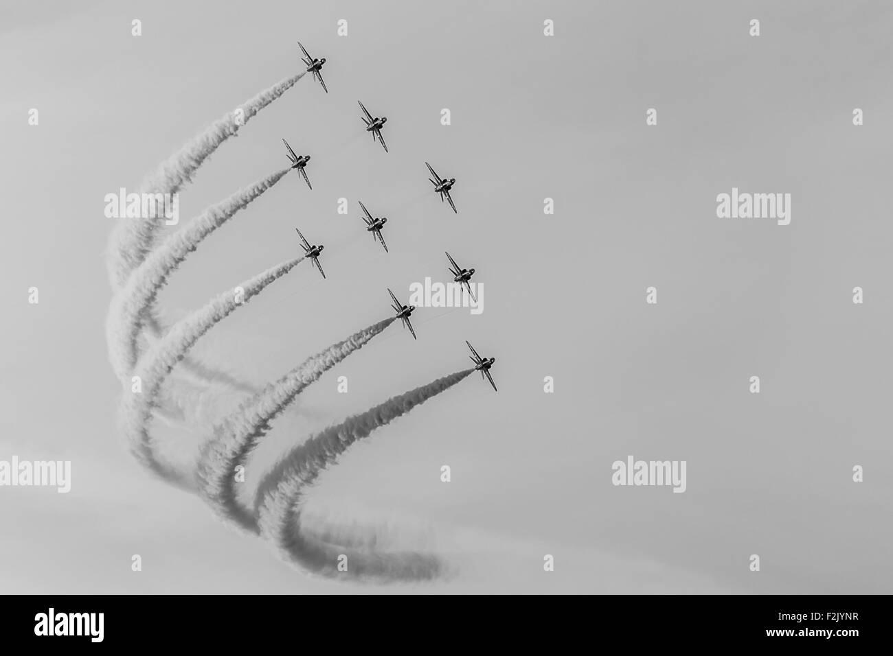 Red Arrows diamond nine formation captured in monochrome. - Stock Image