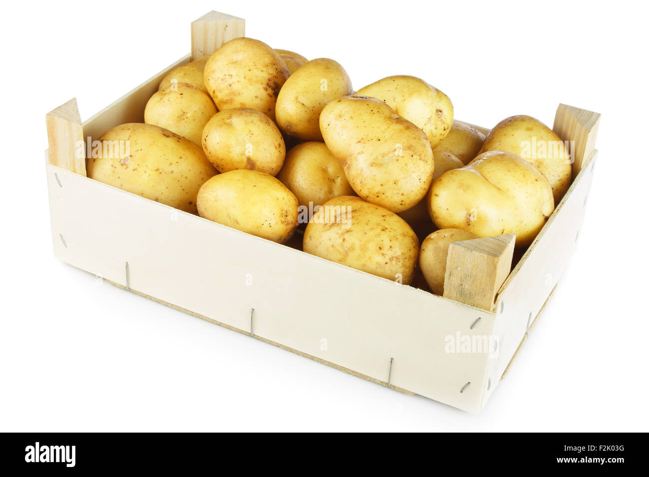 Potato in wooden box isolated on white background - Stock Image
