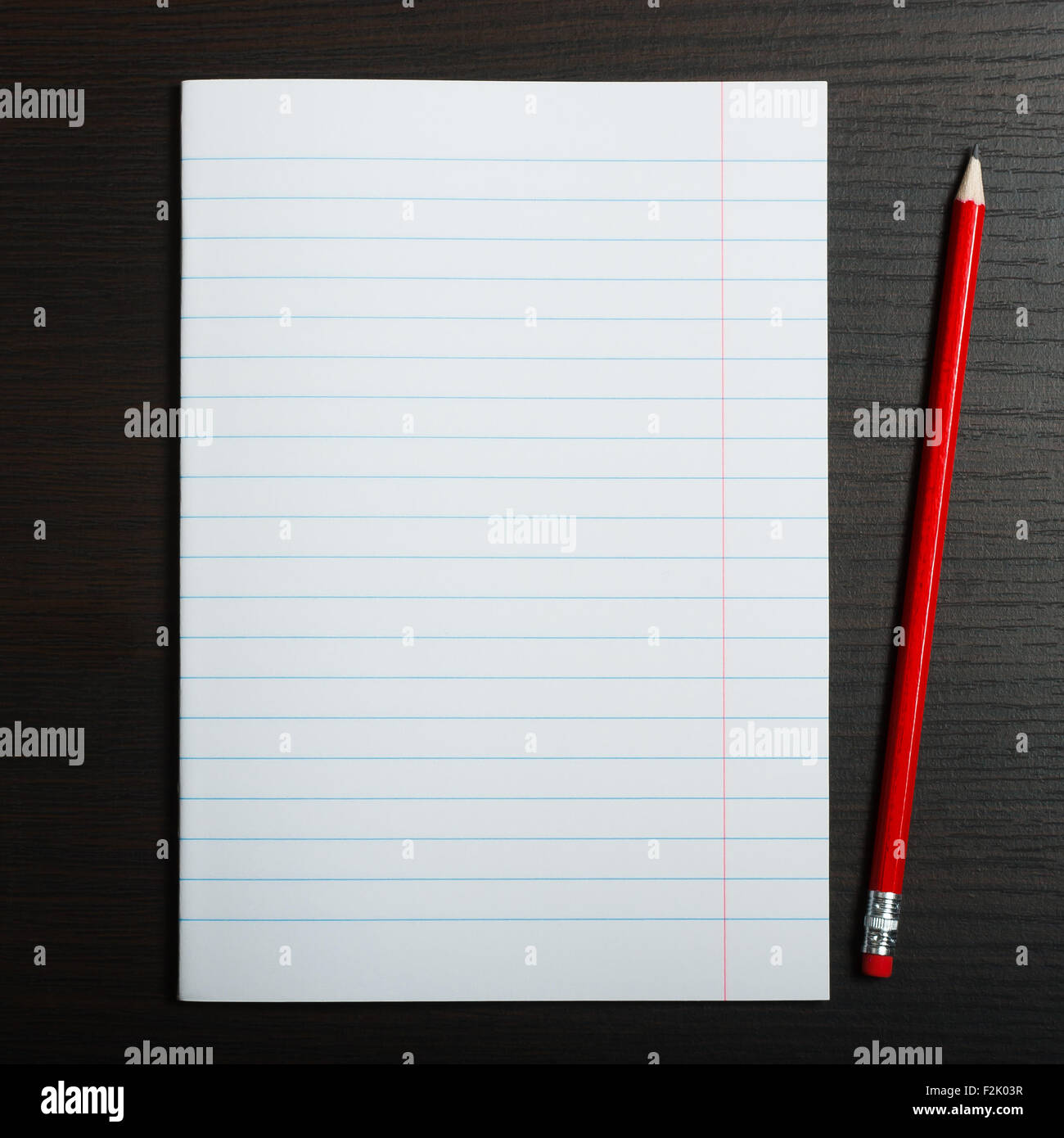 Blank white paper and pencil on wooden desk - Stock Image